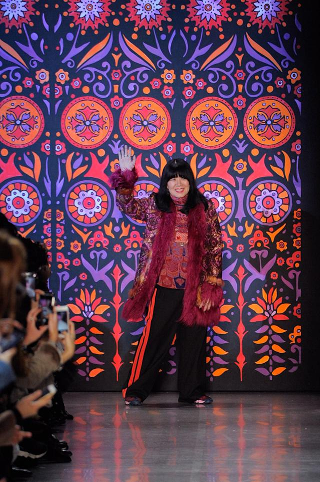 Designer Anna Sui accepts applause after the Fall 2018 collection show. (Photo: Ron Adar/WireImage)