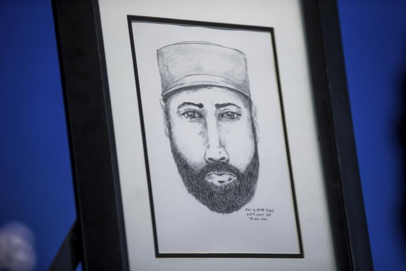 A sketch of a man who the Royal Canadian Mounted Police say interacted with Lucas Fowler and Chynna Deese is displayed during a news conference, in Surrey, British Columbia, on Monday July 22, 2019. Lucas, a 23-year-old Australian who, along with his girlfriend Chynna Deese, 24, of Charlotte, N.C., were found dead in Northern British Columbia last week. (Darryl Dyck/The Canadian Press via AP)