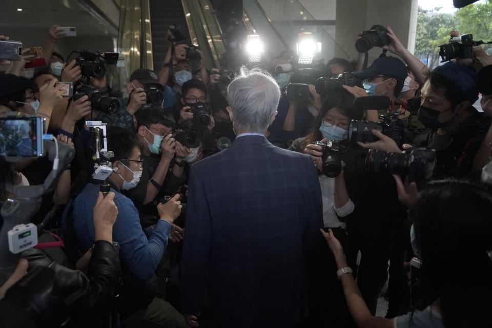 Pro-democracy activist Martin Lee, center, arrives at a court in Hong Kong Friday, April 16, 2021. Seven of Hong Kong's leading pro-democracy advocates, including Lee and pro-democracy media tycoon Jimmy Lai, are expected to be sentenced Friday for organizing a march during the 2019 anti-government protests that triggered an overwhelming crackdown from Beijing. (AP Photo/Kin Cheung)