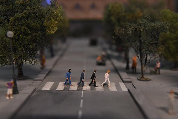 A miniature model of the iconic image, the Beatles crossing Abbey Road, part of Gulliver's Gate, a miniature world being recreated in a 49,000-square-foot exhibit space in Times Square, is seen during a preview April 10, 2017 in New York City. The exhibit includes miniature scale models of well-known sites and places from around the world.