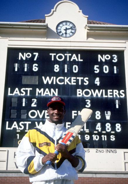 6 JUN 1994:  WARWICKSHIRE BATSMAN BRIAN LARA  POSES WITH HIS BAT IN FRONT OF THE SCOREBOARD RECORDING HIS HISTORIC FEAT AFTER BREAKING THE WORLD RECORD FOR THE HIGHEST EVER INDIVIDUAL SINGLE INNINGS SCORE WITH A SCORE OF 501 NOT OUT AGAINST DURHAM TODAY.Mandatory Credit: Ben Radford/ALLSPORT