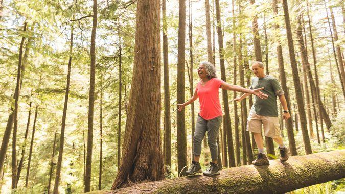 Cute senior couple explore the Pacific Northwest together on a day hiking trip.
