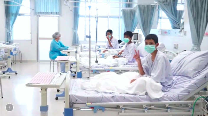 <em>Three of the 12 boys are seen recovering in their hospital beds after being rescued from the cave in Thailand (AP)</em>