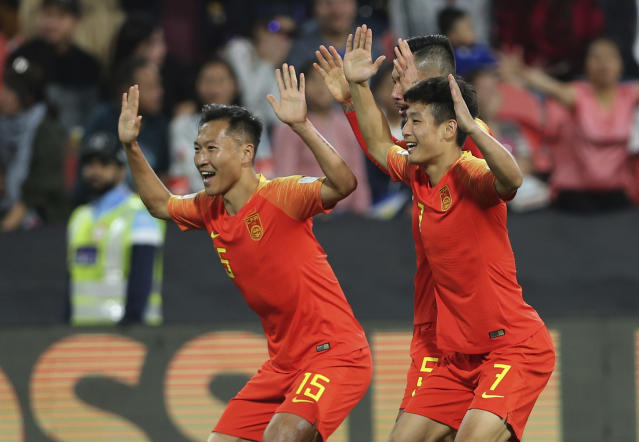 China's defender Wu Lei, right, celebrates his opening goal with his teammate China's defender Wu Xi, left, during the AFC Asian Cup group C soccer match between China and Phillipines at Mohammed Bin Zayed Stadium in Abu Dhabi, United Arab Emirates, Friday, Jan. 11, 2019. (AP Photo/Kamran Jebreili)