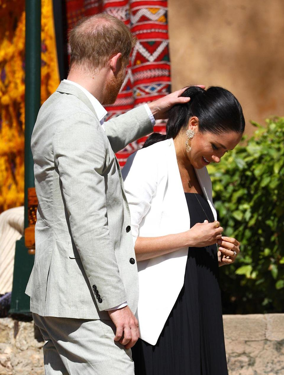 <p>Prince Harry took a moment from his tour of Morocco to help fix his wife's ponytail. The gesture was more endearing than goofy, but tremendously candid. </p>