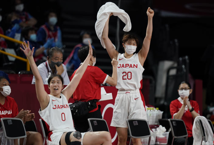 Japan players at the bench celebrate after three point basket during women's basketball preliminary round game against France at the 2020 Summer Olympics, Tuesday, July 27, 2021, in Saitama, Japan. (AP Photo/Charlie Neibergall)