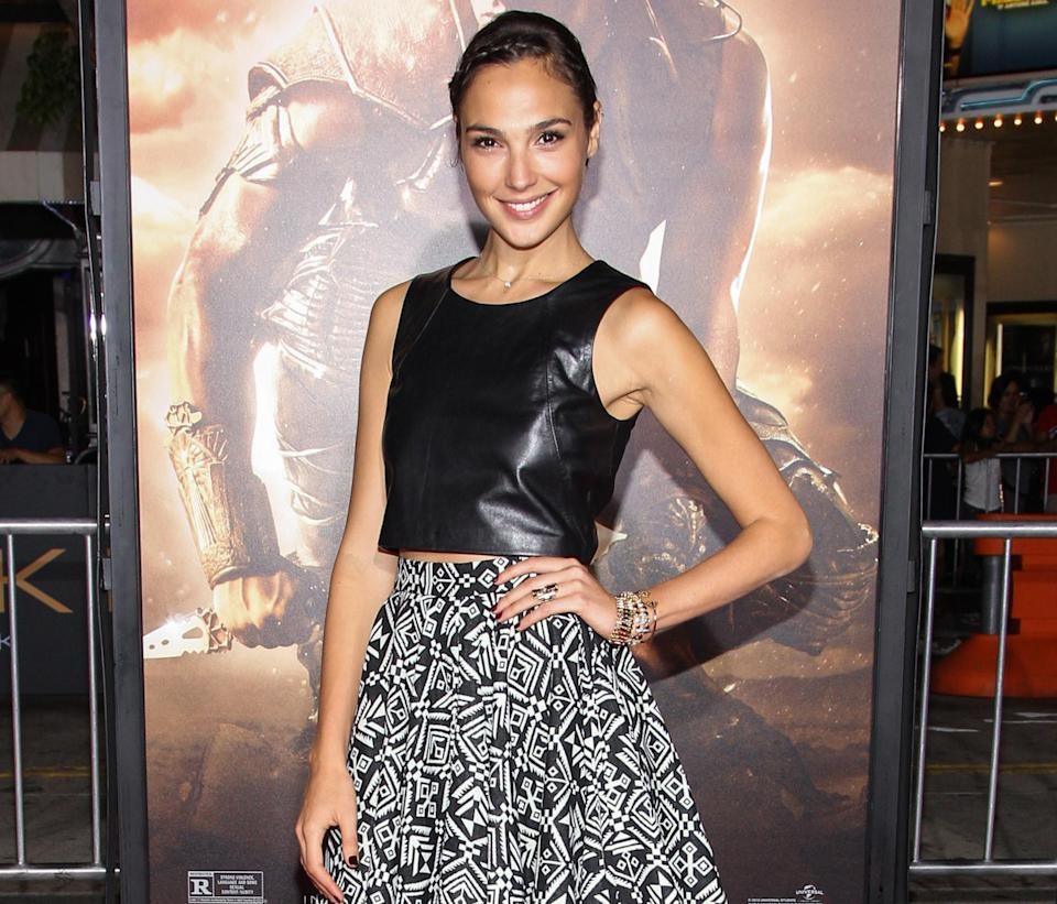 "FILE- In this Aug. 28, 2013 file photo, actress Gal Gadot arrives at the world premiere of ""Riddick"" at the Mann Village Westwood Theater in Los Angeles. Gadot has been cast as Wonder Woman in Warner Bros. superhero team-up film with Batman and Superman. Warner Bros. made the casting announcement Wednesday, Dec. 4, 2013. (Photo by Paul A. Hebert/Invision/AP, File)"