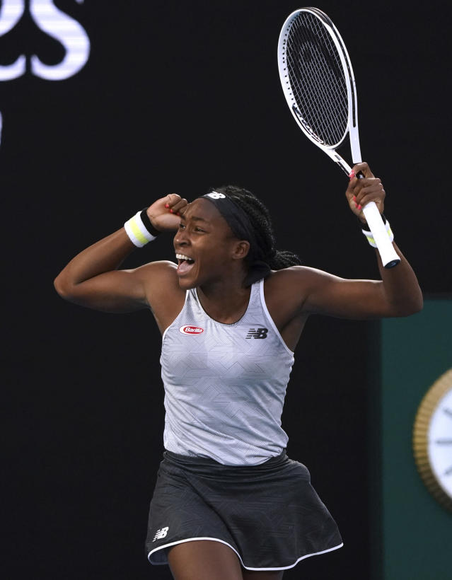 Coco Gauff of the U.S. celebrates after defeating Japan's Naomi Osaka in their third round singles match at the Australian Open tennis championship in Melbourne, Australia, Friday, Jan. 24, 2020. (AP Photo/Lee Jin-man)