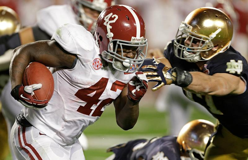 Alabama's Eddie Lacy runs during the first half of the BCS National Championship college football game against Notre Dame Monday, Jan. 7, 2013, in Miami. (AP Photo/Chris O'Meara)