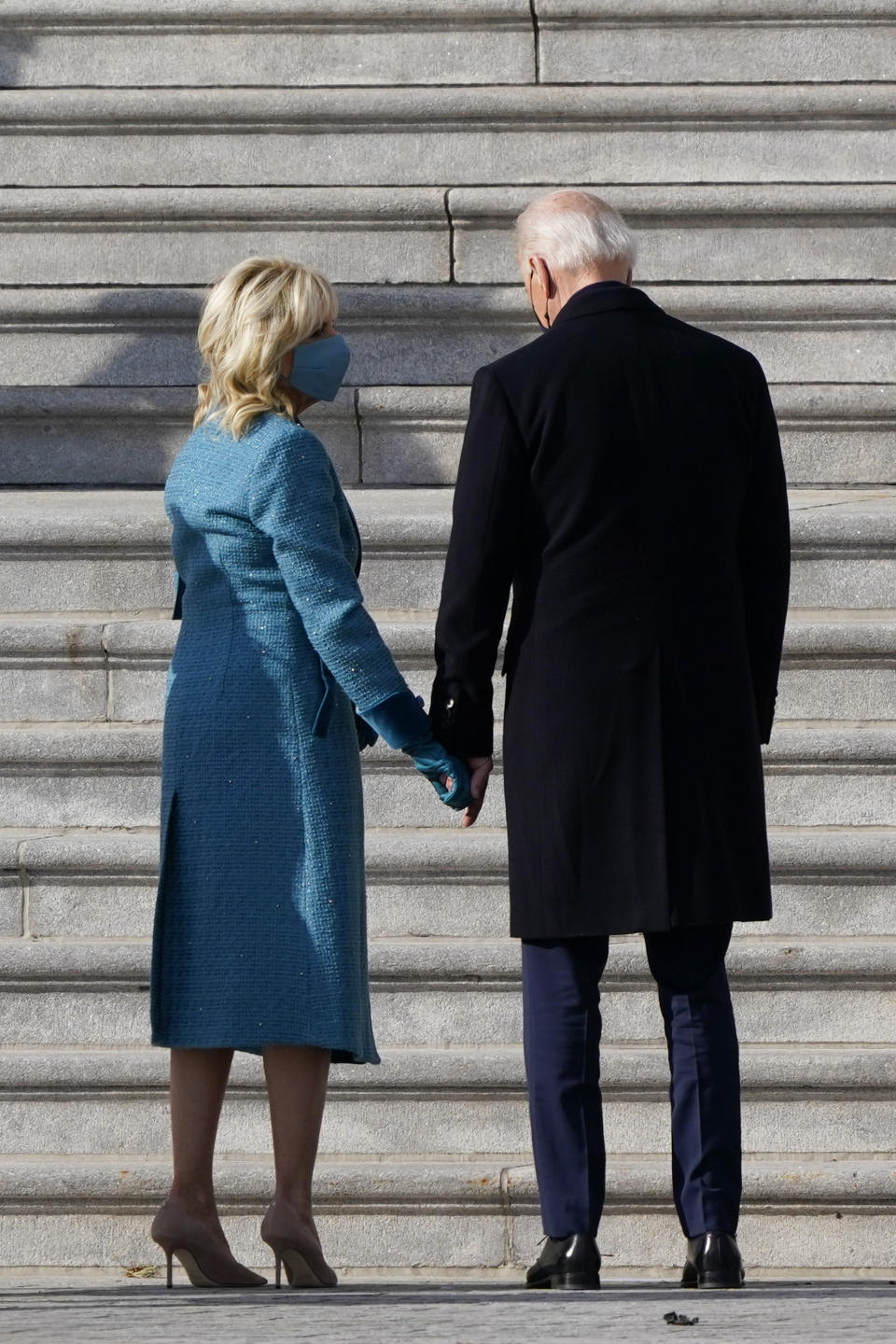 President-elect Joe Biden and his wife Jill Biden arrive at the steps of the U.S. Capitol for the start of the official inauguration ceremonies, in Washington, Wednesday, Jan. 20, 2021. (AP Photo/J. Scott Applewhite)