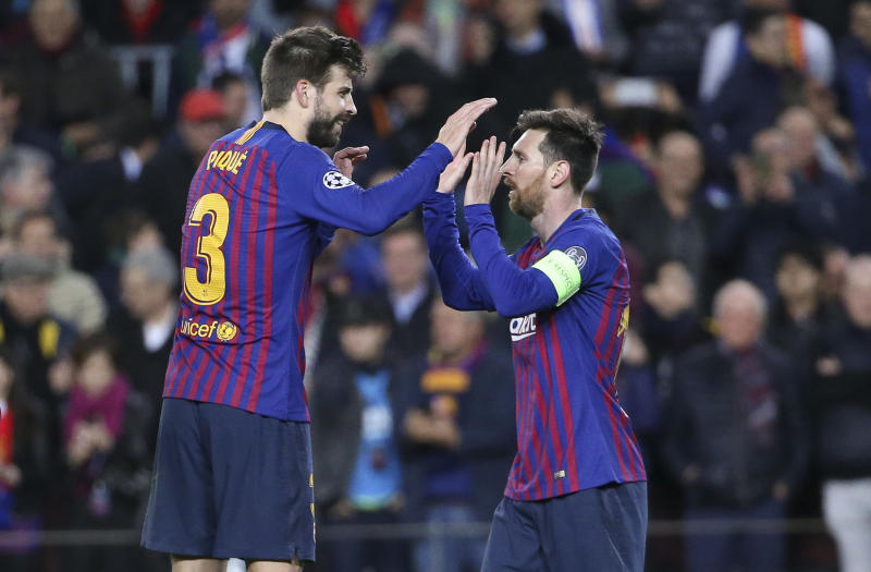 BARCELONA, SPAIN - MARCH 13: Gerard Pique and Lionel Messi of Barcelona celebrate the 5th goal during the UEFA Champions League Round of 16 Second Leg match between FC Barcelona and Olympique Lyonnais (OL, Lyon) at Camp Nou stadium on March 13, 2019 in Barcelona, Spain. (Photo by Jean Catuffe/Getty Images)