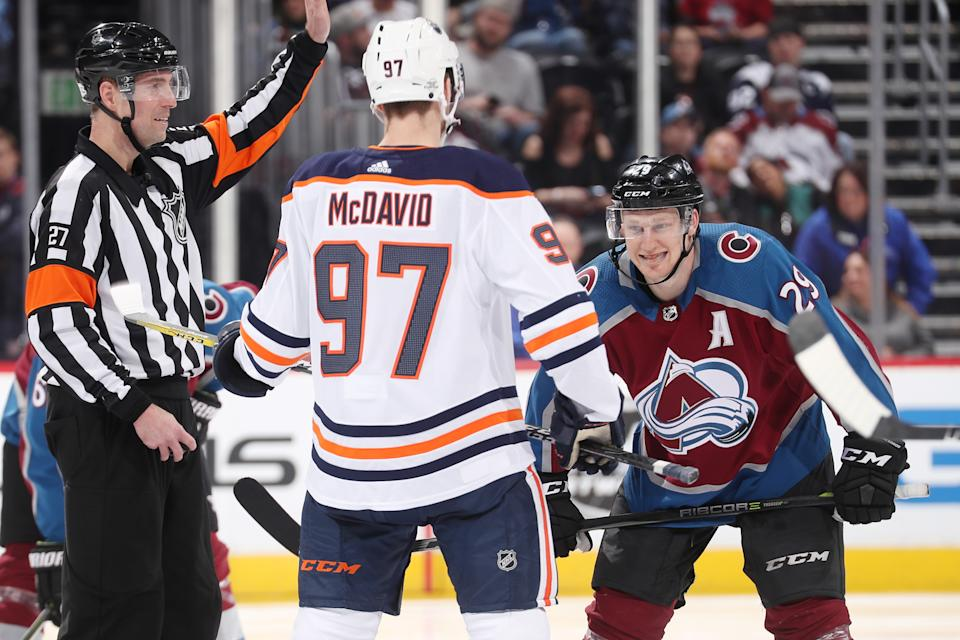 Nathan MacKinnon #29 of the Colorado Avalanche prepares for a face-off against Connor McDavid #97 of the Edmonton Oilers