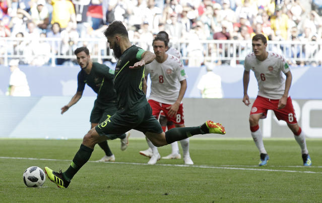 Australia's Mile Jedinak scores his side's opening goal from the penalty spot during the group C match between Denmark and Australia at the 2018 soccer World Cup in the Samara Arena in Samara, Russia, Thursday, June 21, 2018. (AP Photo/Gregorio Borgia)
