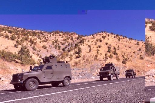 A Turkish military convoy patrols a highway near the border with Iraq in 2011. Kurdish rebels stormed a Turkish army post on the Iraq border Sunday, triggering fighting that killed 22 people in the latest clash since Ankara launched a major offensive against the outlawed PKK