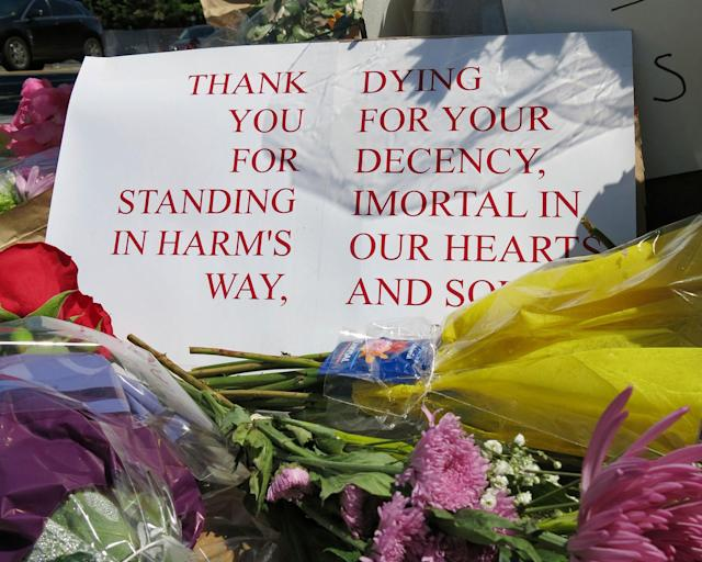 <p>A sign of thanks rests against a traffic light pole at a memorial outside the transit center in Portland, Ore. on Saturday, May 27, 2017. People stopped with flowers, candles, signs and painted rocks for two bystanders who were stabbed to death Friday, while trying to stop a man who was yelling anti-Muslim slurs and acting aggressively toward two young women, including one wearing a Muslim head covering, on a light-trail train in Portland. (AP Photo/Gillian Flaccus) </p>