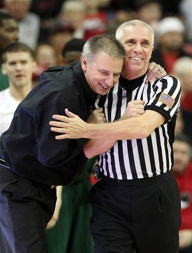 Colorado State head coach Larry Eustachy, left, embraces official Shawn Lehigh during the second half of an NCAA college basketball game against UNLV on Wednesday, Feb. 20, 2013, in Las Vegas. UNLV defeated Colorado State 61-59. (AP Photo/Isaac Brekken)