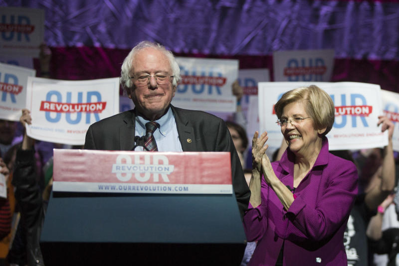 BOSTON, MA - MARCH 31: Vermont Senator and former Presidential candidate Bernie Sanders (I Ð VT) and Senator Elizabeth Warren (D-MA) speak at the Our Revolution Massachusetts Rally at the Orpheum Theatre on March 31, 2017 in Boston, Massachusetts. (Photo by Scott Eisen/Getty Images)