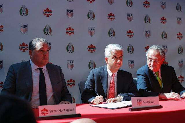 Football bosses from Canada, Mexico and the US announce a bid to become the first three-way co-hosts in the history of FIFA's showpiece tournament (AFP Photo/KENA BETANCUR)