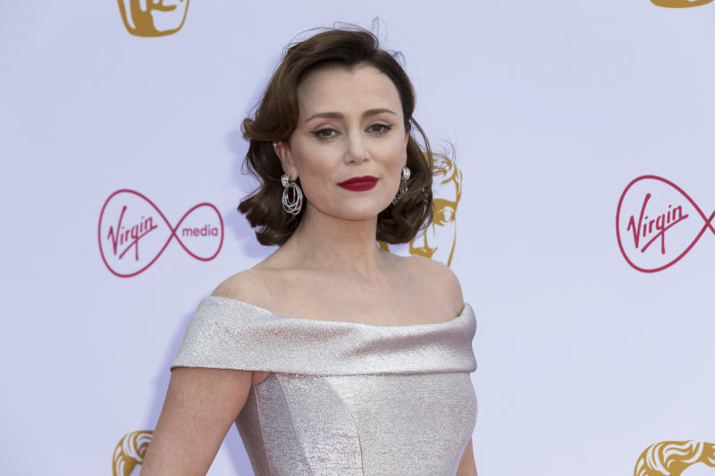 Actress Keeley Hawes poses for photographers on arrival at the 2019 BAFTA Television Awards in London, Sunday, May 12, 2019.(Photo by Grant Pollard/Invision/AP)