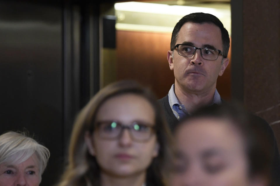 Tim Morrison, the top Russia official on President Trump's National Security Council, gets off of an elevator as he returns to Capitol Hill in Washington, Wednesday, Nov. 6, 2019, to review his testimony before the House impeachment inquiry last week. (AP Photo/Susan Walsh)