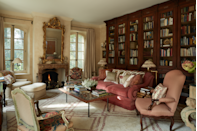 """<p>Designer <a href=""""https://bunnywilliams.com/"""" rel=""""nofollow noopener"""" target=""""_blank"""" data-ylk=""""slk:Bunny Williams"""" class=""""link rapid-noclick-resp"""">Bunny Williams</a> restored the ethereal charm of this France farmhouse by echoing influences from the home's Provence setting inside. This once-boxy space was transformed into a comfortable library filled with pedigreed antiques. The room's custom sofa is topped with a vintage Turkish textile. A <a href=""""http://www.cowtan.com/"""" rel=""""nofollow noopener"""" target=""""_blank"""" data-ylk=""""slk:Cowtan & Tout"""" class=""""link rapid-noclick-resp"""">Cowtan & Tout</a> fabric covers the armchair and ottoman. The custom rug is by <a href=""""https://studiofournyc.com/"""" rel=""""nofollow noopener"""" target=""""_blank"""" data-ylk=""""slk:Studio Four NYC"""" class=""""link rapid-noclick-resp"""">Studio Four NYC</a>. </p>"""