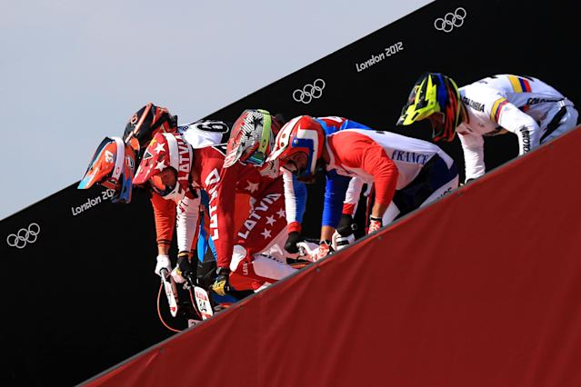 LONDON, ENGLAND - AUGUST 09: Riders start the race down the ramp during the Men's BMX Cycling Quarter Finals on Day 13 of the London 2012 Olympic Games at BMX Track on August 9, 2012 in London, England. (Photo by Phil Walter/Getty Images)