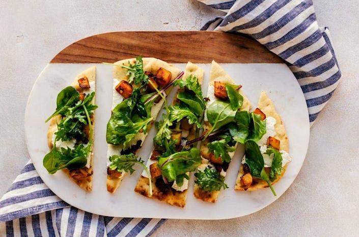 """<p>Fun fact: When sugar pumpkins are diced and roasted, they taste a lot like butternut squash! The naturally sweet flavor of sugar pumpkins is delicious when paired with caramelized onions, as shown here, for this fall-flavored pizza.</p><p><strong>Get the recipe at <a href=""""https://cookienameddesire.com/pumpkin-pizza/"""" rel=""""nofollow noopener"""" target=""""_blank"""" data-ylk=""""slk:A Cookie Named Desire"""" class=""""link rapid-noclick-resp"""">A Cookie Named Desire</a>. </strong> </p>"""