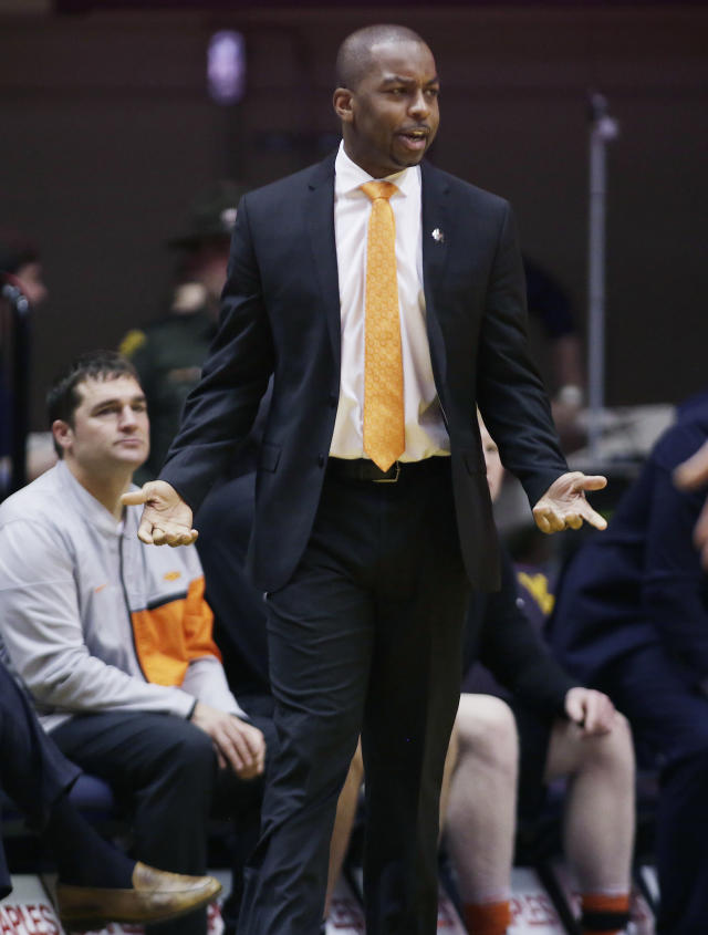 Oklahoma State head coach Mike Boynton questions a referees call during the first half of an NCAA college basketball game against West Virginia Saturday, Jan. 12, 2019, in Morgantown, W.Va. (AP Photo/Raymond Thompson)