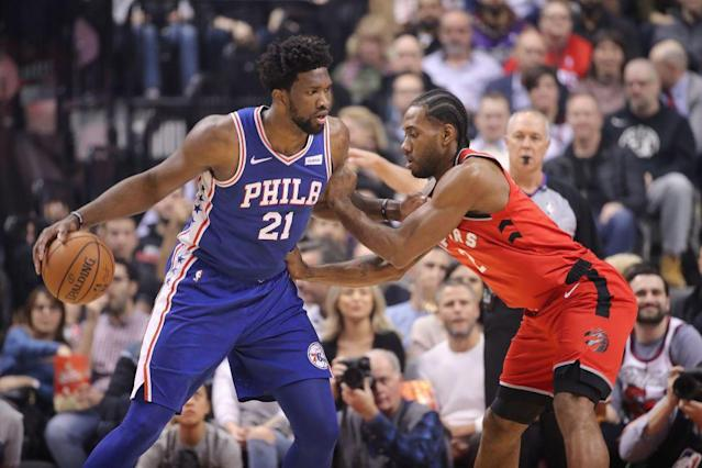 Joel Embiid and Kawhi Leonard both have a chance to be the best players in the 76ers-Raptors series. (Getty Images)