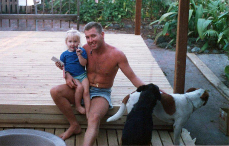 Murdered Queensland woman Toya Cordingley is pictured as a little girl, sitting on her dad Troy's lap.