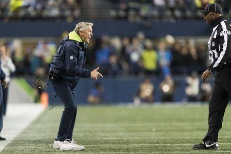 Dec 23, 2018; Seattle, WA, USA; Seattle Seahawks head coach Pete Carroll yells at head linesman Phil McKinnely (110) during the second half at CenturyLink Field. Seattle defeated Kansas City 38-31. Mandatory Credit: Steven Bisig-USA TODAY Sports