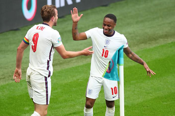 LONDON, ENGLAND - JUNE 29: Harry Kane of England celebrates with Raheem Sterling after scoring a goal to make it 2-0 during the UEFA Euro 2020 Championship Round of 16 match between England and Germany at Wembley Stadium on June 29, 2021 in London, United Kingdom. (Photo by Robbie Jay Barratt - AMA/Getty Images)