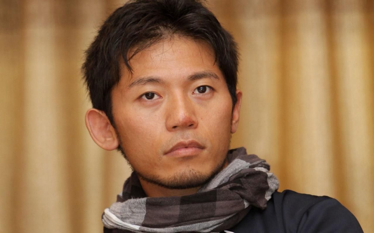 """A Japanese climber, who lost nine fingertips to frostbite in a previous expedition, died on Monday during an attempt to climb Mount Everest, an official said, the second person to die on the world's highest mountain during the current climbing season. Nobukazu Kuriki, 36, was found dead while sleeping in a camp 2 tent at 7,400 metres (24,278 feet) on the 8,850-metre (29,035-feet) mountain, tourism department official Gyanendra Shrestha said from base camp. """"Sherpas found his body inside the tent,"""" Shrestha told Reuters. Details of the incident are not immediately available due to poor communication with the higher camp, he said. Kuriki had made seven unsuccessful attempts to scale Everest. In 2012, Kuriki spent two days in a snow hole at 27,000 feet (8,230 metres) on Everest in temperatures below minus 20 Celsius. That was when he had to have his fingertips amputated. Japanese climber Nobukazu Kuriki poses with a Nepalese flag during a press conference in August 2015 before an attempt to be the first to scale Mount Everest since the April 2015 earthquake Credit: Bikram Rai/AP Macedonian Gjeorgi Petkov, 63, died at the weekend climbing Everest, hiking officials said without giving details. Scores of climbers have successfully made it to the top of Everest this month taking the benefit of good weather, officials said. Nepal has allowed more than 340 foreign climbers to ascend the peak during the current season which started in March and continues through this month."""