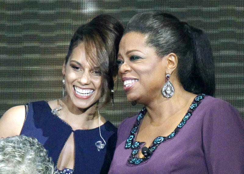 """FILE - This May 17, 2011 file photo shows singer Alicia Keys, left, and Oprah Winfrey during a taping of """"Surprise Oprah! A Farewell Spectacular,""""  in Chicago. Keys announced Tuesday, July 10, 2012 that her organization Keep a Child Alive will pay homage to Winfrey at its Black Ball event on Nov. 1. Winfrey's humanitarian efforts include the building of schools in South Africa. (AP Photo/Charles Rex Arbogast, file)"""