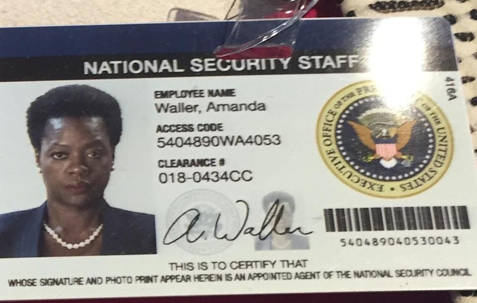 <p>Close-up of her ID badge. Those are some pretty major credentials.</p>