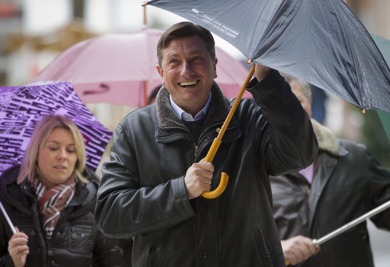 Slovenia's former prime minister Borut Pahor arrives at a polling station in Sempeter, Slovenia, Sunday, Dec. 2, 2012. Small, crisis-hit EU member Slovenia is choosing a president in an atmosphere of uncertainty and growing discontent with cost-cutting measures designed to avoid an international bailout. (AP Photo/Darko Bandic)