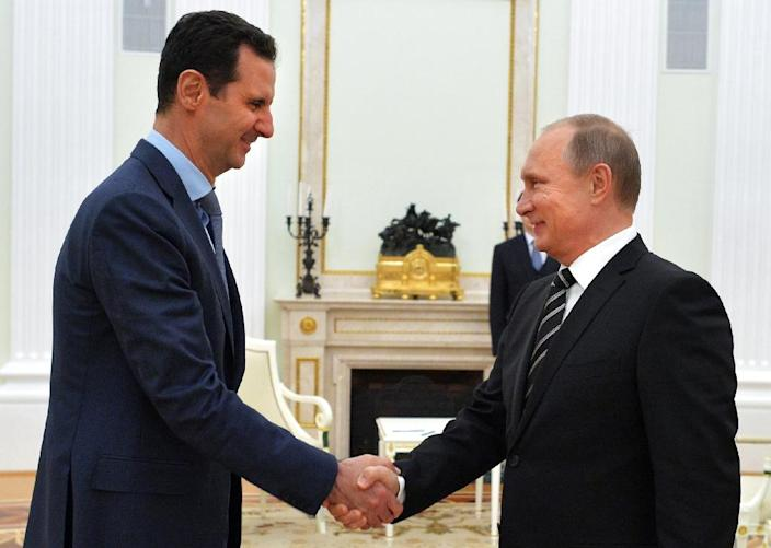 Syrian leader Bashar al-Assad (left) travelled to Moscow for talks with his Russian counterpart Vladimir Putin in October 2015 (AFP Photo/Alexey Druzhinin)