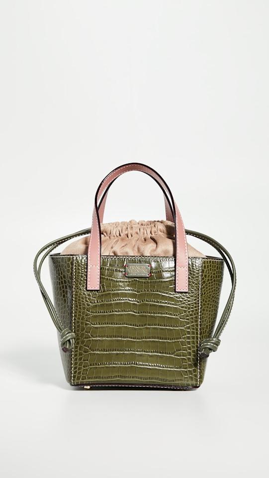 """<p>The drawstring top on this <a href=""""https://www.popsugar.com/buy/Frances-Valentine-Moxy-Tote-478863?p_name=Frances%20Valentine%20Moxy%20Tote&retailer=shopbop.com&pid=478863&price=298&evar1=fab%3Aus&evar9=46489553&evar98=https%3A%2F%2Fwww.popsugar.com%2Fphoto-gallery%2F46489553%2Fimage%2F46489894%2FFrances-Valentine-Moxy-Tote&list1=shopping%2Cfall%20fashion%2Caccessories%2Cbags%2Ctrends%2Cpurses%2Chandbags&prop13=api&pdata=1"""" rel=""""nofollow"""" data-shoppable-link=""""1"""" target=""""_blank"""" class=""""ga-track"""" data-ga-category=""""Related"""" data-ga-label=""""https://www.shopbop.com/moxy-tote-frances-valentine/vp/v=1/1508379477.htm?folderID=13505&amp;fm=other-viewall&amp;os=false&amp;colorId=85479"""" data-ga-action=""""In-Line Links"""">Frances Valentine Moxy Tote</a> ($298) will keep your belongings secure.</p>"""