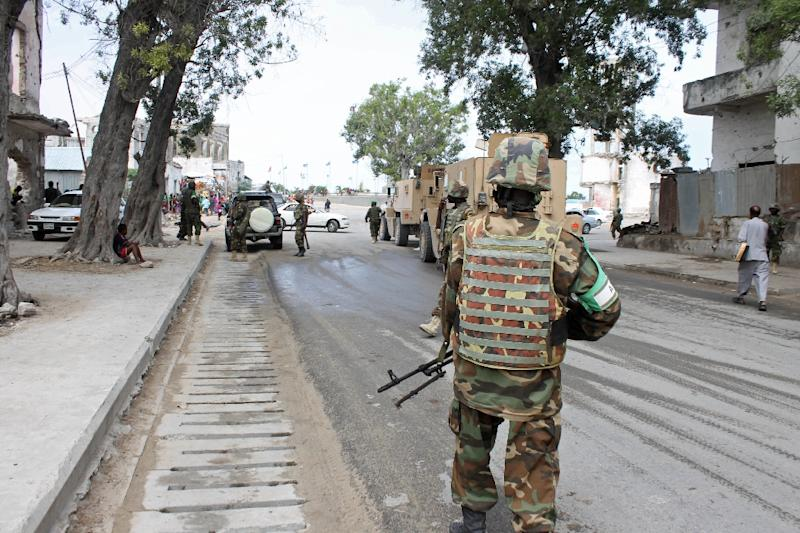 Soldiers of the African Union Mission in Somalia (AMISOM) secure an area near the Godka Jillicow prison in Mogadishu on August 31, 2014