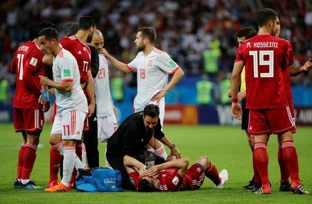 Soccer Football - World Cup - Group B - Iran vs Spain - Kazan Arena, Kazan, Russia - June 20, 2018 Iran's Saeid Ezatolahi receives treatment from medical staff after sustaining an injury REUTERS/Jorge Silva