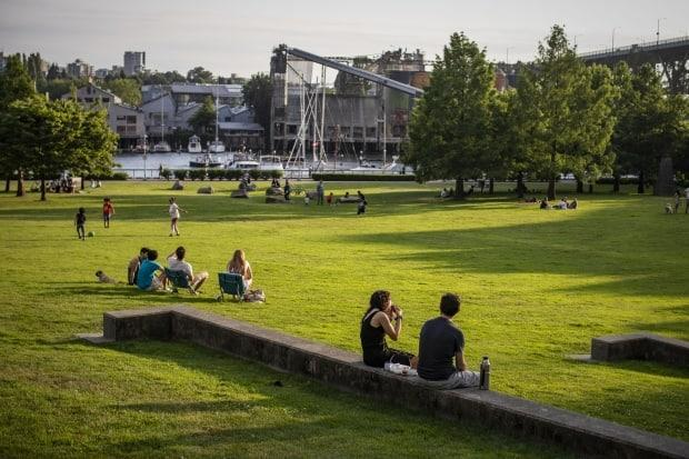 Groups of people are pictured at a park in Vancouver on July 1, the day B.C. entered Step 3 of its reopening. (Ben Nelms/CBC - image credit)