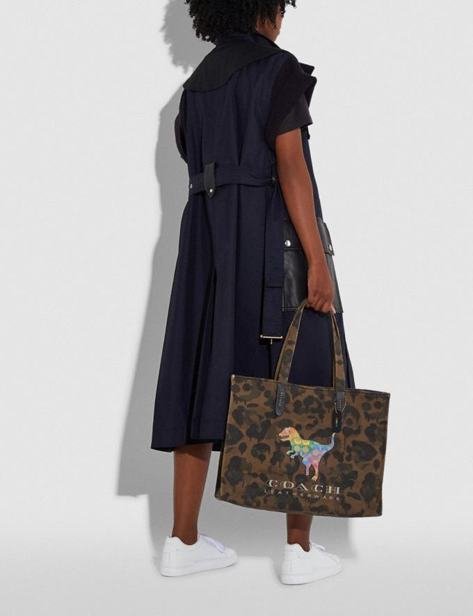 """<p>Try something different and snag this cool <a href=""""https://www.popsugar.com/buy/Coach-42-Rainbow-Signature-Rexy-Tote-586129?p_name=Coach%2042%20With%20Rainbow%20Signature%20Rexy%20Tote&retailer=coach.com&pid=586129&price=195&evar1=fab%3Aus&evar9=37613336&evar98=https%3A%2F%2Fwww.popsugar.com%2Ffashion%2Fphoto-gallery%2F37613336%2Fimage%2F47586742%2FCoach-42-With-Rainbow-Signature-Rexy-Tote&list1=shopping%2Cbags%2Csummer%20fashion%2Cfashion%20shopping&prop13=mobile&pdata=1"""" rel=""""nofollow"""" data-shoppable-link=""""1"""" target=""""_blank"""" class=""""ga-track"""" data-ga-category=""""Related"""" data-ga-label=""""https://www.coach.com/coach-tote-42-with-rainbow-signature-rexy/986.html?utm_campaign=PRIDE&amp;utm_source=facebook.com&amp;utm_medium=organic_soc&amp;fbclid=IwAR0mLNa9oVNKXiRhT4R22owo5oAAKjQh4MXexTKIB_U7-PGakAQcfnWLcBE"""" data-ga-action=""""In-Line Links"""">Coach 42 With Rainbow Signature Rexy Tote</a> ($195).</p>"""