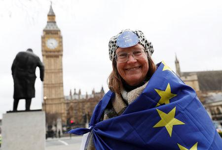 An anti-Brexit protester stands in Westminster on the day Prime Minister Theresa May will announce that she has triggered the process by which Britain will leave the European Union, in London