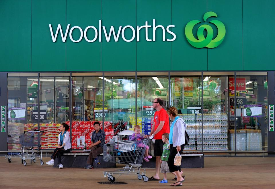 Shoppers outside a Woolworths grocery store in Brisbane, Tuesday, April 19, 2011.