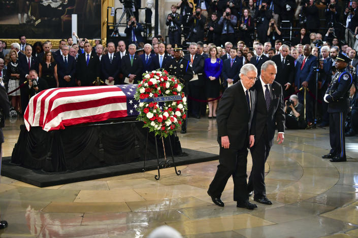"""<span class=""""s1"""">Republican Mitch McConnell and Democrat Chuck Schumer, leaders of the Senate, leave the casket during a ceremony at the Capitol rotunda on Friday. (Photo: Kevin Dietsch/Pool Photo via AP)</span>"""