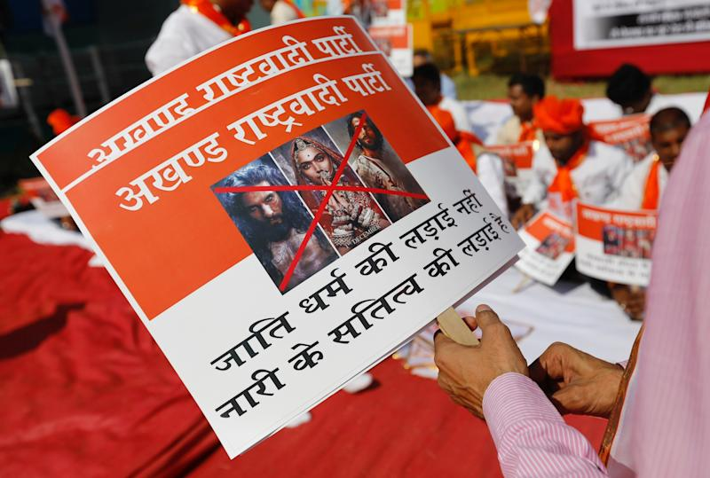 """Members of the Rajput community protest against the release of the upcoming Bollywood movie 'Padmaavat' in Mumbai, India, January 20, 2018. The bottom half of the sign reads """"It's not the fight for caste religion, it's the fight for devotion of a woman."""" (REUTERS/Danish Siddiqui)"""