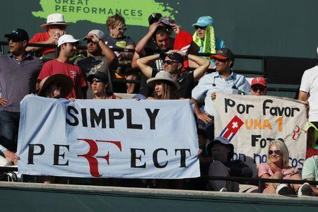 Mar 24, 2018; Key Biscayne, FL, USA; Fans hold a banner in the stands between games during the match between Thanasi Kokkinakis of Australia and Roger Federer of Switzerland (both not pictured) on day five of the Miami Open at Tennis Center at Crandon Park. Kokkinakis won 3-6, 6-3, 7-6(4). Mandatory Credit: Geoff Burke-USA TODAY Sports