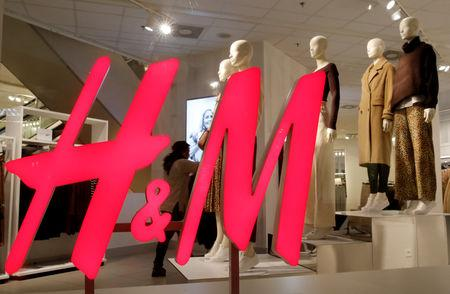 FILE PHOTO: The logo of H&M is seen in a display window of a store in Zurich, Switzerland January 7, 2019. REUTERS/Arnd Wiegmann/File Photo
