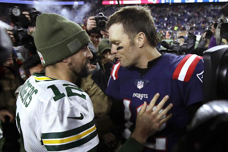 Green Bay Packers quarterback Aaron Rodgers, left, and New England Patriots quarterback Tom Brady speak at midfield after an NFL football game, Sunday, Nov. 4, 2018, in Foxborough, Mass. (AP Photo/Charles Krupa)