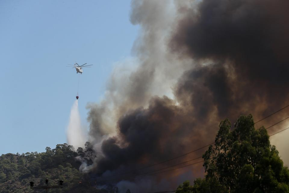 MUGLA, TURKEY - AUGUST 02: Helicopters battle the forest fire broke out in Marmaris district of Mugla as ground and aerial extinguishing operations continue on August 02, 2021 in Mugla, Turkey. Turkish authorities maintain their tireless efforts to contain forest fires that erupted in various parts of the country, particularly the southern regions. (Photo by Omer Evren Atalay/Anadolu Agency via Getty Images)